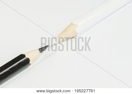 Black and white pencil as conceptual imagination of opposites