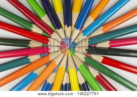 Abstract composition of complementary cirkel with color pencils against a white background