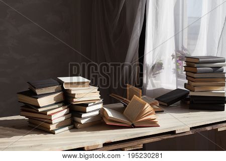 many books are on the table at home in the library 1