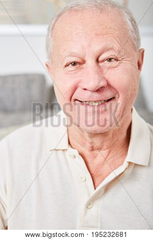 Senior man as retiree smiles content with satisfaction