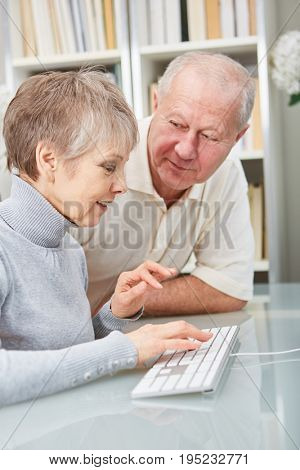 Seniors learn in computer class about technology