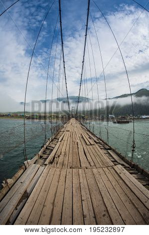 Trift Bridge is the longest pedestrian-only suspension bridge at the foot of the Belukha mountain, Altai Mountains, Russia.