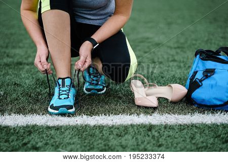 Getting Ready For Training. The Concept Of Female Feet After Work.
