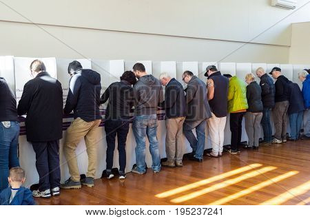 Melbourne, Australia - July 2, 2016: voters inside a polling booth on the 2016 federal election date.