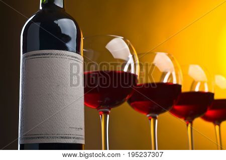 Bottle and glasses of red wine . Old paper label .Copy space . Free space for your text .