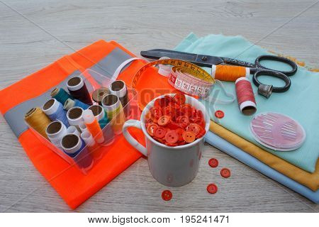 tailor workspace with sewing and handmade tools. tools for sewing for hobby. instruments sewing craft on wooden background close up