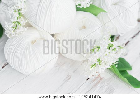 Natural cotton linen and viscose mixed yarn skeins with needles close-up. Spring and summer season knitting.