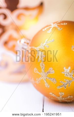 Bright yellow Christmas tree bauble with sparkling silver snow flake ornament golden angel flare magic greeting card copy space greeting card