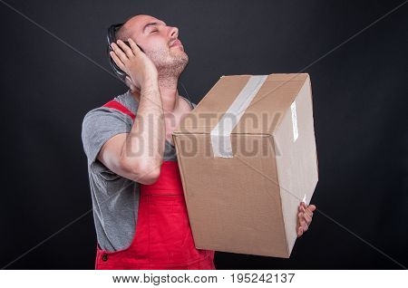 Mover Guy Holding Box And Listening To Headset