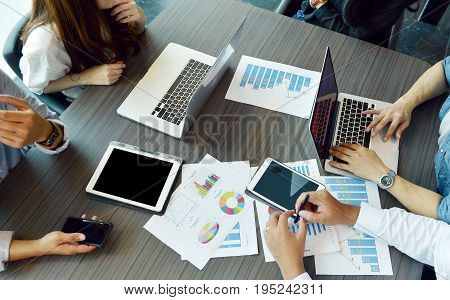 Technology equipment with tablet laptop business documents on meeting table