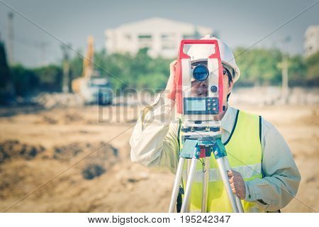 Civil Engineer Use Surveyor Equipment Theodolite Checking Construction Site For New Infrastructure P