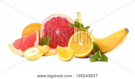 Various citrus fruits isolated on a bright background. Sweet tropical banana and green mint leaves. Red ripe grapefruits chopped in pieces. Tasteful organic summer fruits.