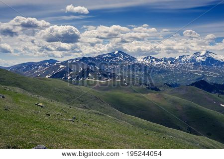 Fantastic Mountain Scenery - Low Clouds Are Floating In A Deep Blue Sky