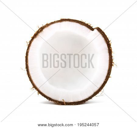 A delicious coconut cut in half in a white isolated background. Cracked bright coco full of nutrients. Organic summer ingredients. Healthy vegan lifestyle.