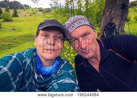 Funny Couple Of Travelers Taking Selfie On Alpine Meadow