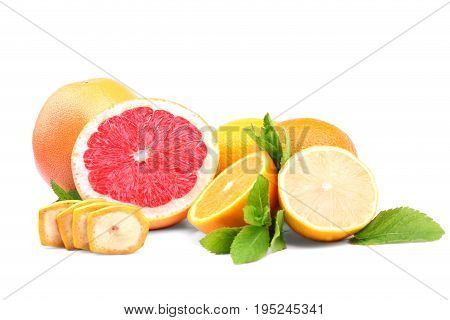 A group of citrus fruits isolated on a white background. Fresh lemons cut in half. Tropical red grapefruits. Whole nutritious fruits and mint leaves. Delicious chopped banana.