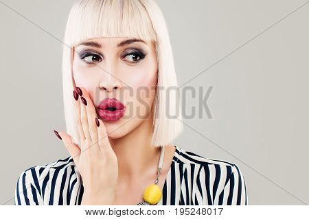 Surprised Woman with Open Mouth. Blondie Fashion Model with Makeup and Bob Hairstyle. Surprised Face Closeup