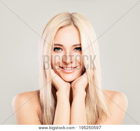 Cute Blonde Woman Fashion Model with Blonde Hair Smiling. Beautiful Girl Pretty Face