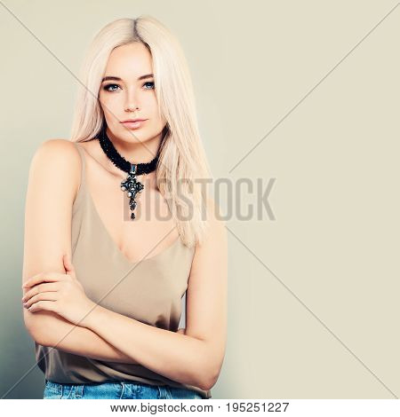 Glamorous Blonde Woman with Long Hair and Makeup Standing on Banner Background
