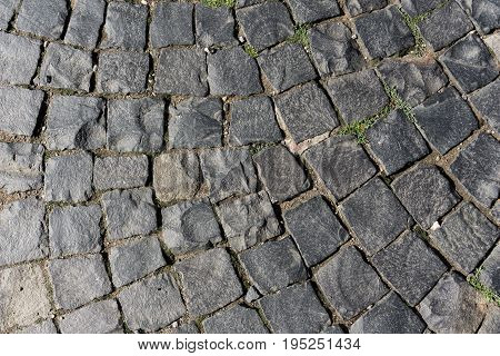 Close-up of Cobblestones in sunlight. View on a Walkway of Cobblestones. Pedestrian Walkway