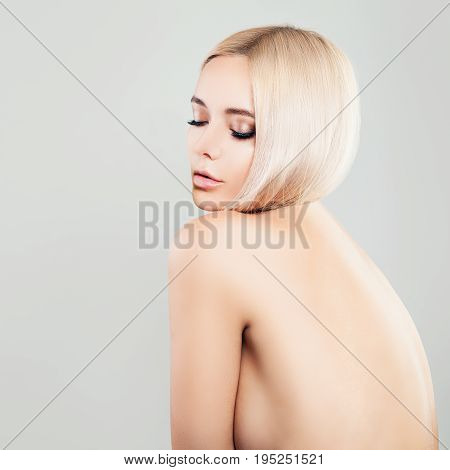 Sensual Blonde Woman Fashion Model on Background with Copy Space Female Back
