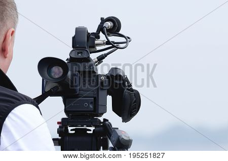 CAMERA - A TV camera on a reporter's stand