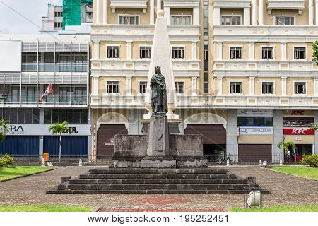 Port Louis Mauritius - December 25 2015: St Louis XVI statue in front of St. Louis Cathedral in Port Louis Mauritius.
