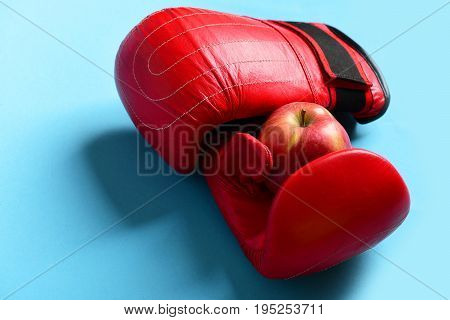 Sport Equipment And Fruit On Bright Blue Background. Boxing Gloves