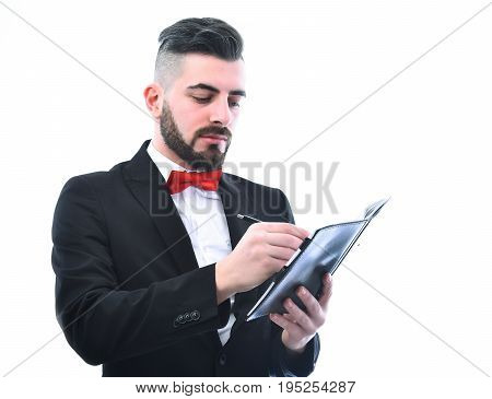 Bearded Businessman With Moustache And Smile Holds Organizer And Writes