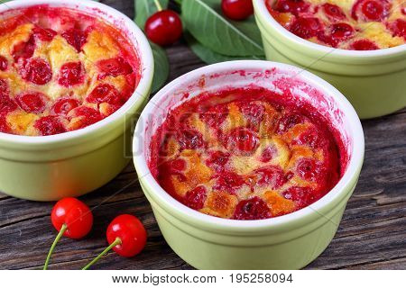 Portions Of Cherry Clafouti In Ceramic Ramekins