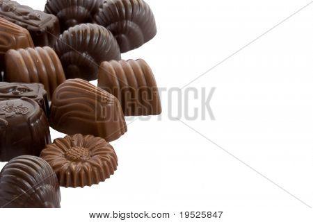 handful of luxury chocolates isolated on white