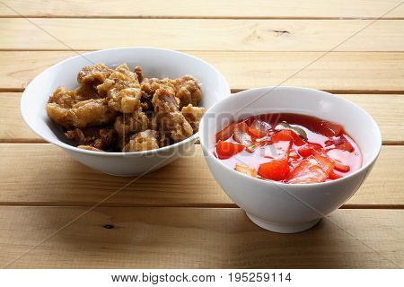 Sweet and Sour Pork on Wooden Background