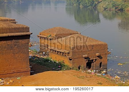 panchaganga ghat-small temples Kolhapur Maharashtra India. A ghat is constructed on Panchaganga river on north west side of Kolhapur city. There are many small & large sized temples surrounding ghat & in actual river also. Panchaganga ghat is constructed