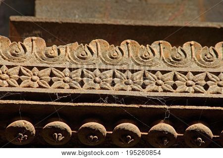 Foral carved design at Panchaganga ghat-shiv mandir Kolhapur Maharashtra India. A ghat is constructed on Panchaganga river on north west side of Kolhapur city. There are many small & large sized temples surrounding ghat & in actual river also. Panchaganga