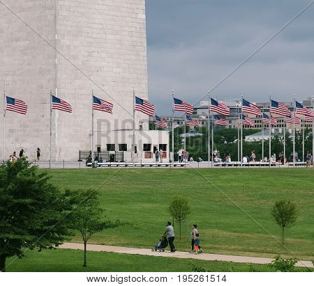 WASHINGTON DC, USA - June, 2017: American flags at the Washington Monument are an obelisk, built to commemorate George Washington, the first American president.