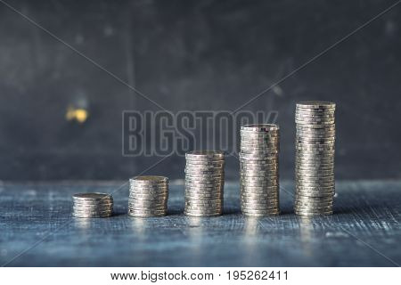 Coin Many piles on the blackboard Natural light