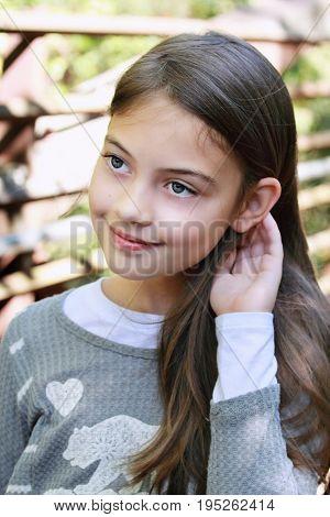 Young beautiful pre-teen girl with long hair.