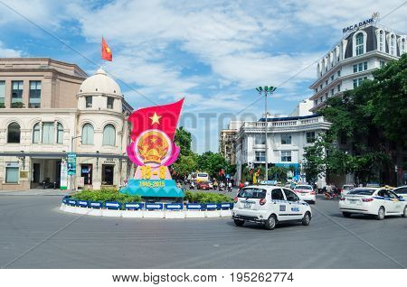 Hanoi, Vietnam - August 16, 2015: Patriotic banner celebrating the 70th anniversary of Vietnam on a roundabout in the French Quarter.