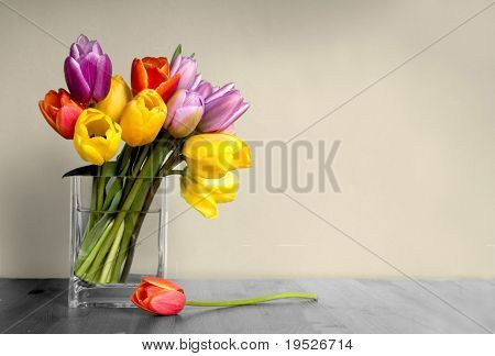 vase of tulips on table
