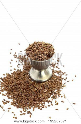 Flax Seeds In A Small Metal Cup On White Background,image
