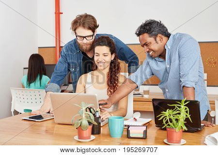 Creative startup business team with computer in workshop