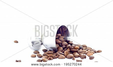 Coffee beans and small metal cup on white background image of a