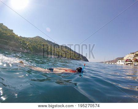 Brunette woman snorkelling