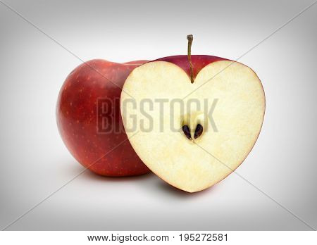 Figure nice red apples in a heart shape
