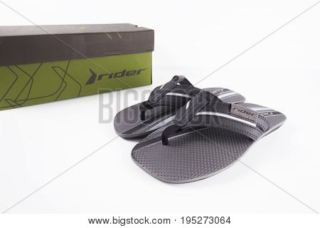 June, 2017: Rider Slipper. Rider Slipper, multinational company. Isolated on white. Product shots.