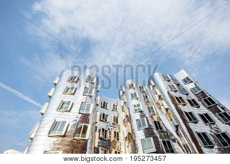 DUSSELDORF, GERMANY - July 04, 2017: Neuer Zollhof complex designed by Frank Gehry architects on the waterfront of the Media Harbour in Dusseldorf