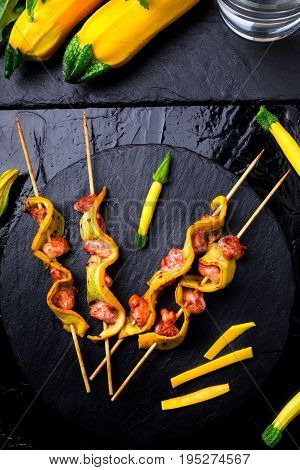 Yellow Zucchini And Chicken Kebab On Wooden Stick On Black Stone Slate Plate. Top View.