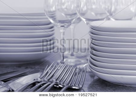 plates, wineglasses, cutlery for home entertaining