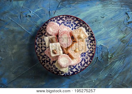 Delicious and Fresh Turkish Delight on Wooden Background