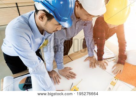Asian engineer or architect meeting for architectural project. working with partner and engineering tools on workplace. Engineer or architect meeting ofr discussing design project.